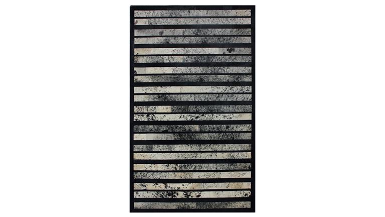 tapis peau de vache gris grizzy mobiliermoss le blog mobilier moss. Black Bedroom Furniture Sets. Home Design Ideas